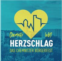 Logo HEZSCHLAG - Chemnitz lebt: Gelbes Herz mit StadtSilhouette